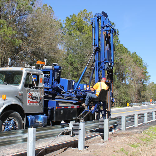 Acme Barricades Employee Installing Metal Guardrails