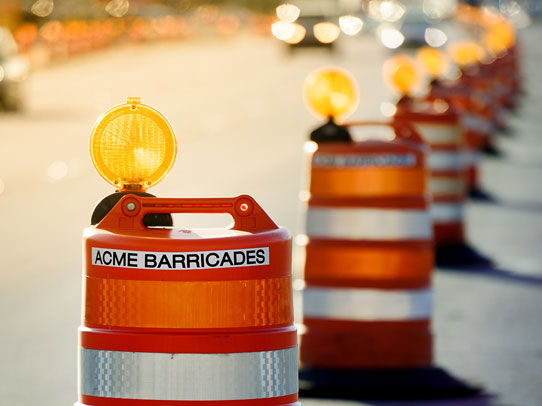 Acme Barricades orange barrels used as temporary traffic control in Florida