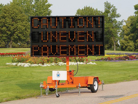 A caution Message Board and variable message boards & signs on a roadway