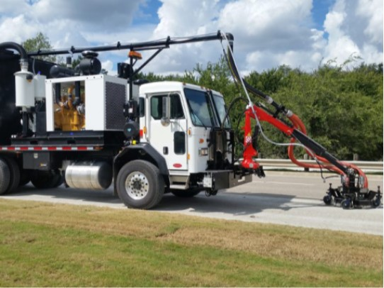 Waterblasting pavement before a roadway project